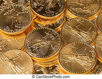 Collection of one ounce gold coins - Stacks of gold eagle...
