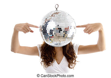 woman balancing mirror ball with fingers with white...