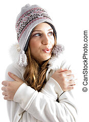 beautiful young female shivering in cold on an isolated...
