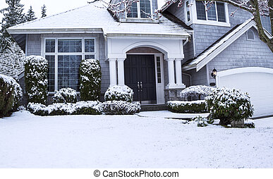 Snow on house and Yard - Horizontal photo of suburban home...