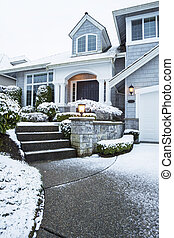Walkway with Snow leading to Home - Vertical photo of side...