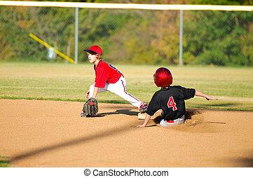 Little league player getting an out - Little league baseball...