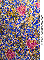 Close up colorful flower pattern on batik fabric bacground