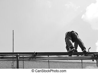 Worker on the roof of building