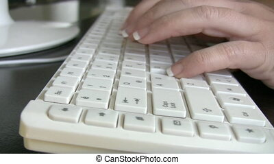 Typing - Close up of a hand typing on keyboard