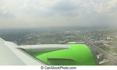 Arriving to Bangkok - Aerial view through the cabin porthole...