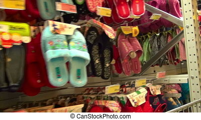 Footwear store - Hundreds of slippers and other footwear in...