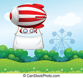 A red and white airship carrying an empty banner