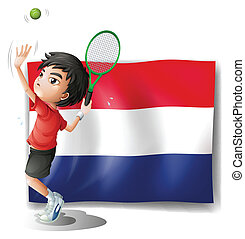 A boy playing tennis in front of the Netherlands flag