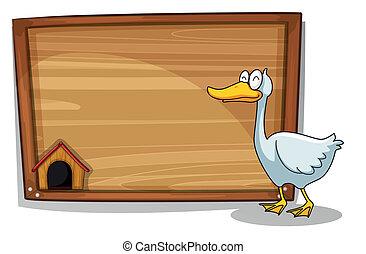 A duck beside a wooden board