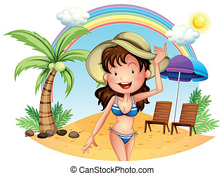 A girl in her swimsuit at the beach