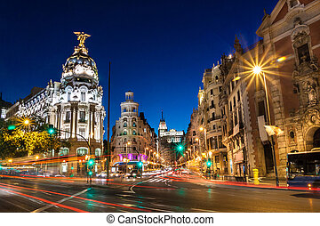 Gran Via in Madrid, Spain, Europe - Rays of traffic lights...