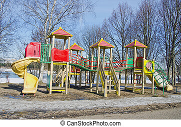 children playground in winter time