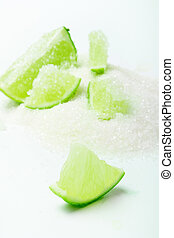 lime with sugar - juicy lime slice on sugar (close up)
