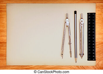 Drawing Table and Tools - Blank Paper and Drawing Tools on...