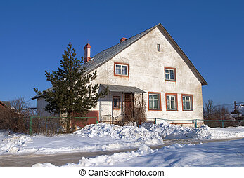 Old white stone cottage in winter time - Old white stone...