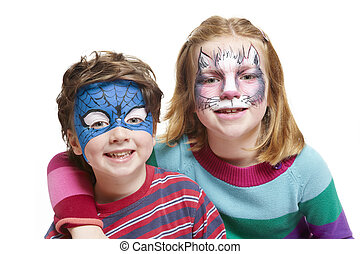 Young boy and girl with face painting cat and superhero -...