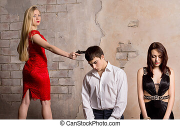 Infidelity - Dangerous woman pointing her gun to a man...