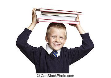 School boy with books on his head - 8 year old school boy...