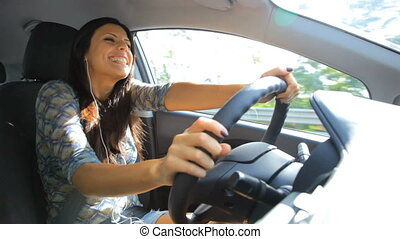 Beautiful woman driving talking