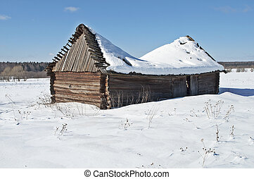 Old wooden barn under snow - Old wooden barn with a...