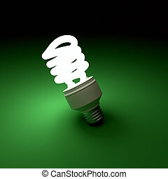 Illuminated light bulb on green background