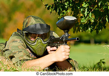paintball player holding fire - paintball player in...