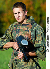 Man paintball player - Serious paintball player man in...