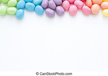 Rainbow Easter - Rainbow color jelly beans on a white...