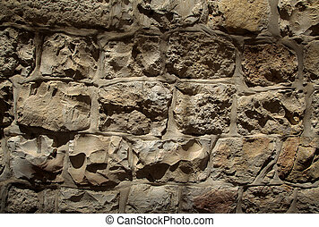 Rough textured yellow stone wall from the famous Jerusalem...