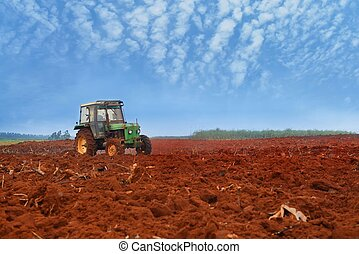 tractor cultivatin soil ready for seeding in spring