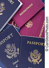 American and German Passports Background - A stack of...