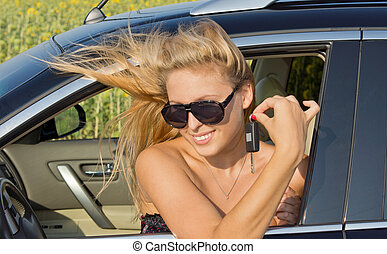 Windblown woman in car - Windblown woman sitting in a car...