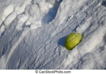 Tennis Ball in Snowbank - a tennis ball embedded in a...