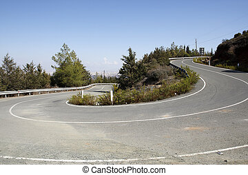 winding mountain road in cyprus - empty mountain road on the...