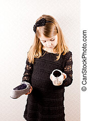 Little girl making a choice of shoes