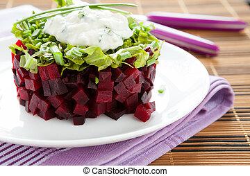 beet salad with fresh herbs and garlic sauce, closeup