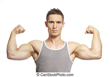 Muscular young man flexing arm muscles in sports outfit...