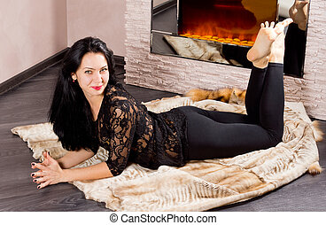 Happy beautiful woman with a lovely smile lying stretched...