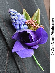 A Button Hole with Muscari and Anemone