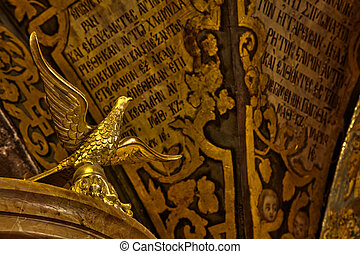 Holy Sepulchre Bird - A bird sculpture made out of gold,...