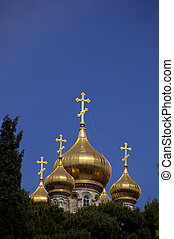 Church of Maria Magdalene Among Trees - The golden towers of...