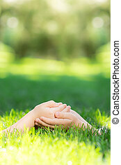 Handful - Empty hands on green grass Ecology concept