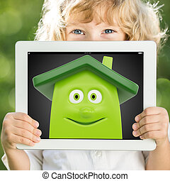 Child holding tablet PC - Happy child holding tablet PC with...