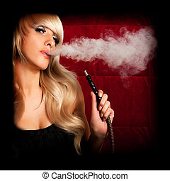 Woman smokes a hookah - Beautiful woman smoking a hookah and...