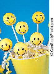 Smiley face cake pops - Round-shaped mini cakes on sticks