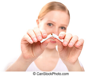 woman breaking cigarette. concept stop smoking - A woman...