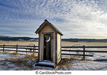 Winter Outhouse - Out in a field covered with snow is this...