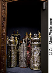 Torah Scrolls Cabinet - An open cabinet with several Torah...