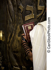 Praying infront of the Bible Cabinet - The left side of a...